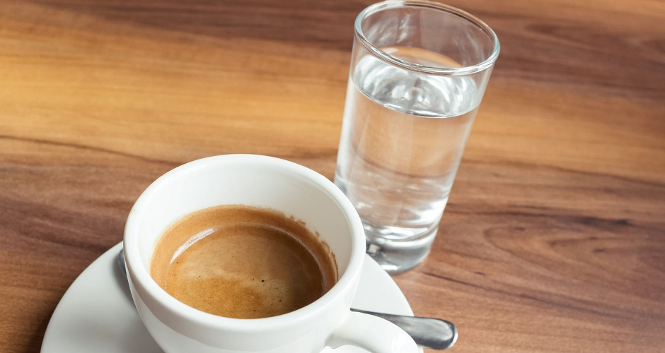 55576789 - a cup of espresso coffee and small glass of fresh water