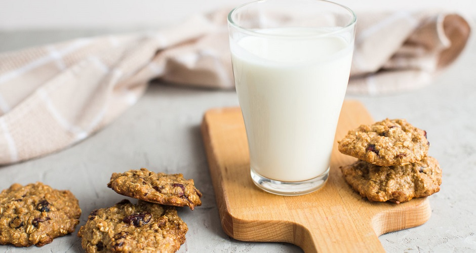 66109944 - breakfast: a glass of milk and homemade oatmeal cookies