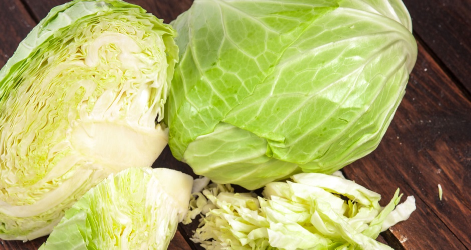 40706543 - cabbages and cut cabbage on old wooden desk