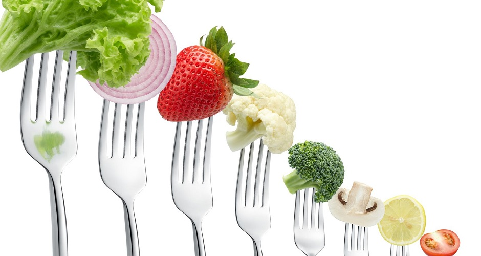 10517688 - forks with vegetables in a row isolated on white