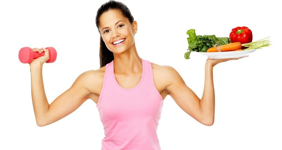 13303085 - portrait of a healthy woman with vegetables and dumbbells promoting a healthy fitness and eating lifestyle