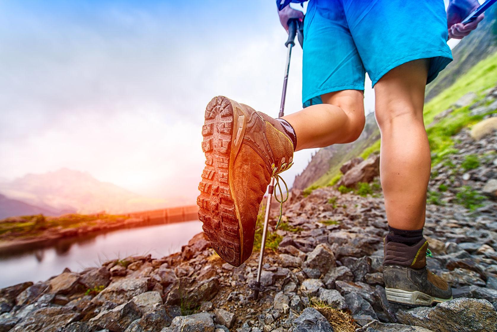 42621589 - hiking boot closeup on mountain trail