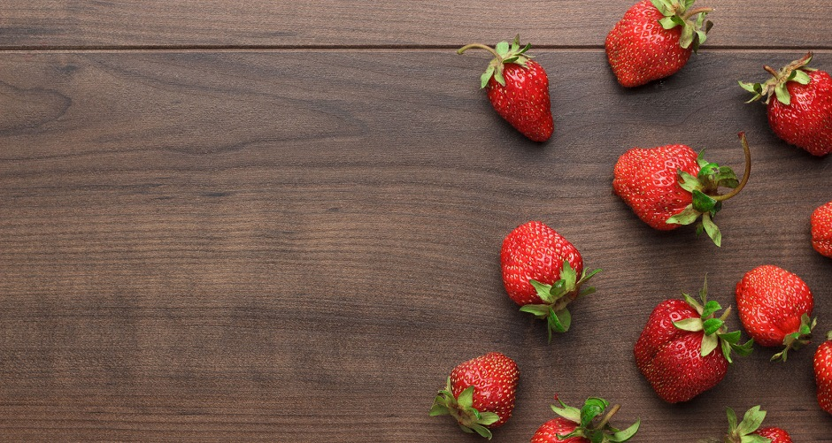 45552882 - fresh strawberries on the brown wooden table