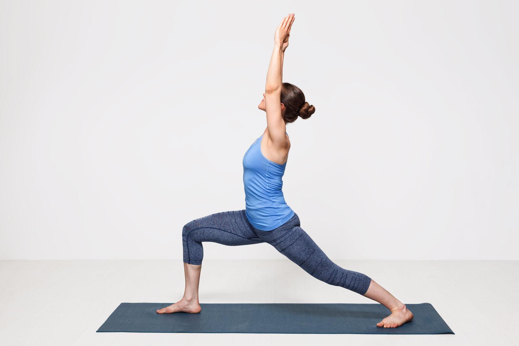 50988754 - beautiful sporty fit yogini woman practices yoga asana virabhadrasana 1 - warrior pose 1