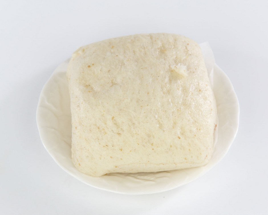 73197662 - steamed bread on white plate