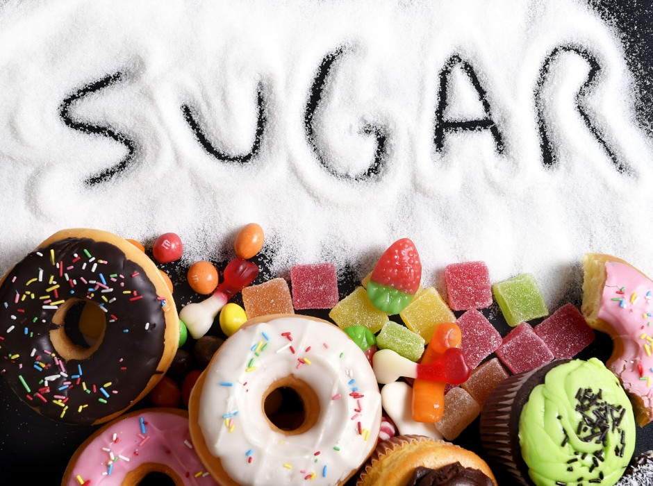 40972446 - mix of sweet cakes, donuts and candy with sugar spread and written text in unhealthy nutrition, chocolate abuse and addiction concept, body and dental care