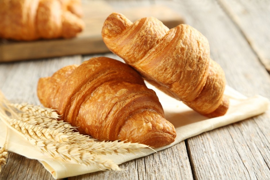 43598759 - tasty croissants with spikelets on grey wooden background