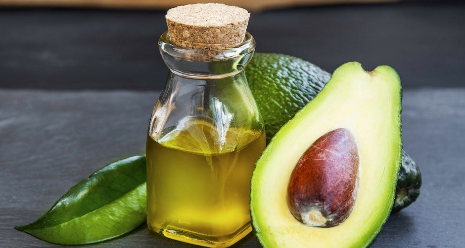 54173891 - avocado oil bottle with avocado fruit on wooden background