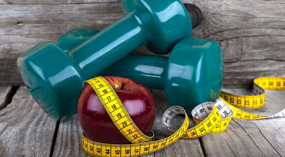 32340148 - measuring tape wrapped around a apple weight loss photo