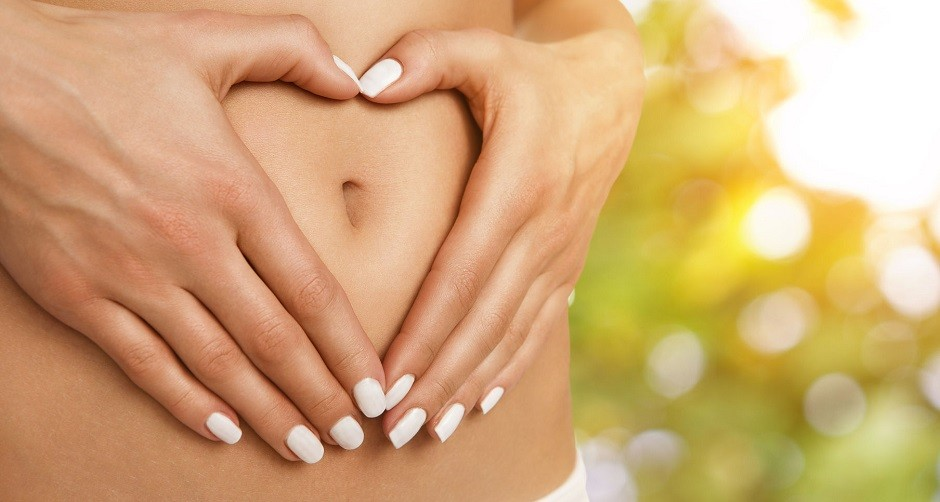 36438536 - body care, pregnancy or diet concept, female hands forming heart shape on the stomach