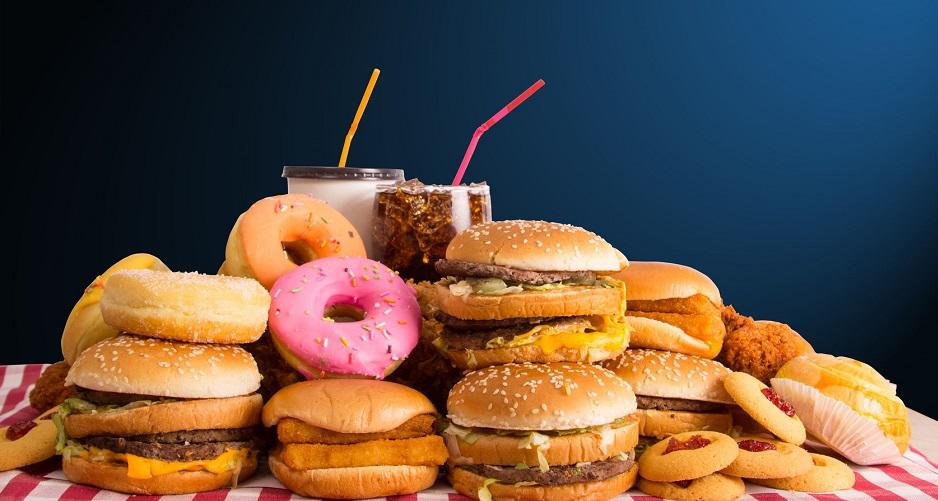 51637877 - multiple type of fast food on table.