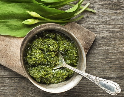 39063044 - wild garlic pesto on wood table closeup