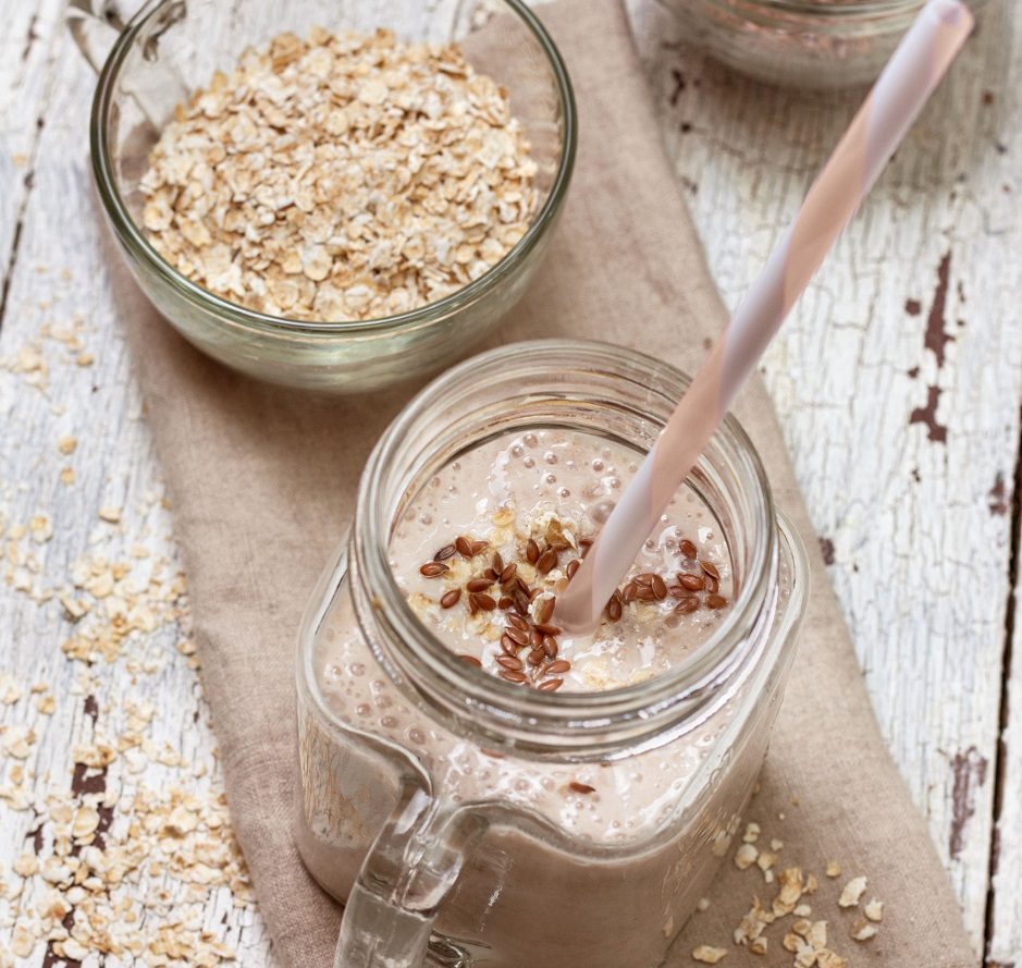 40493332 - smoothies with  oatmeal,  flax seeds in glass jars on a wooden background